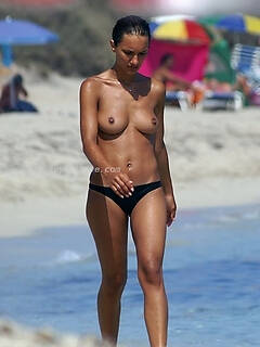 Voyeur shots of some cute naked girls enjoying themselves at the beach